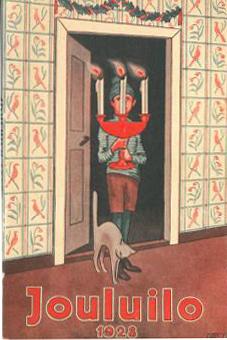 Poika kolmihaarainen kynttelikkö kädessään, jaloissa kissa selkä kaarella.