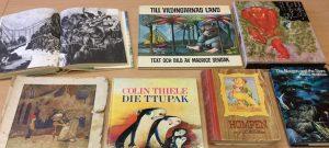 Kirjoja, joissa on erilaisia olioita, näkyvissä mm. Till vildingarnas land.